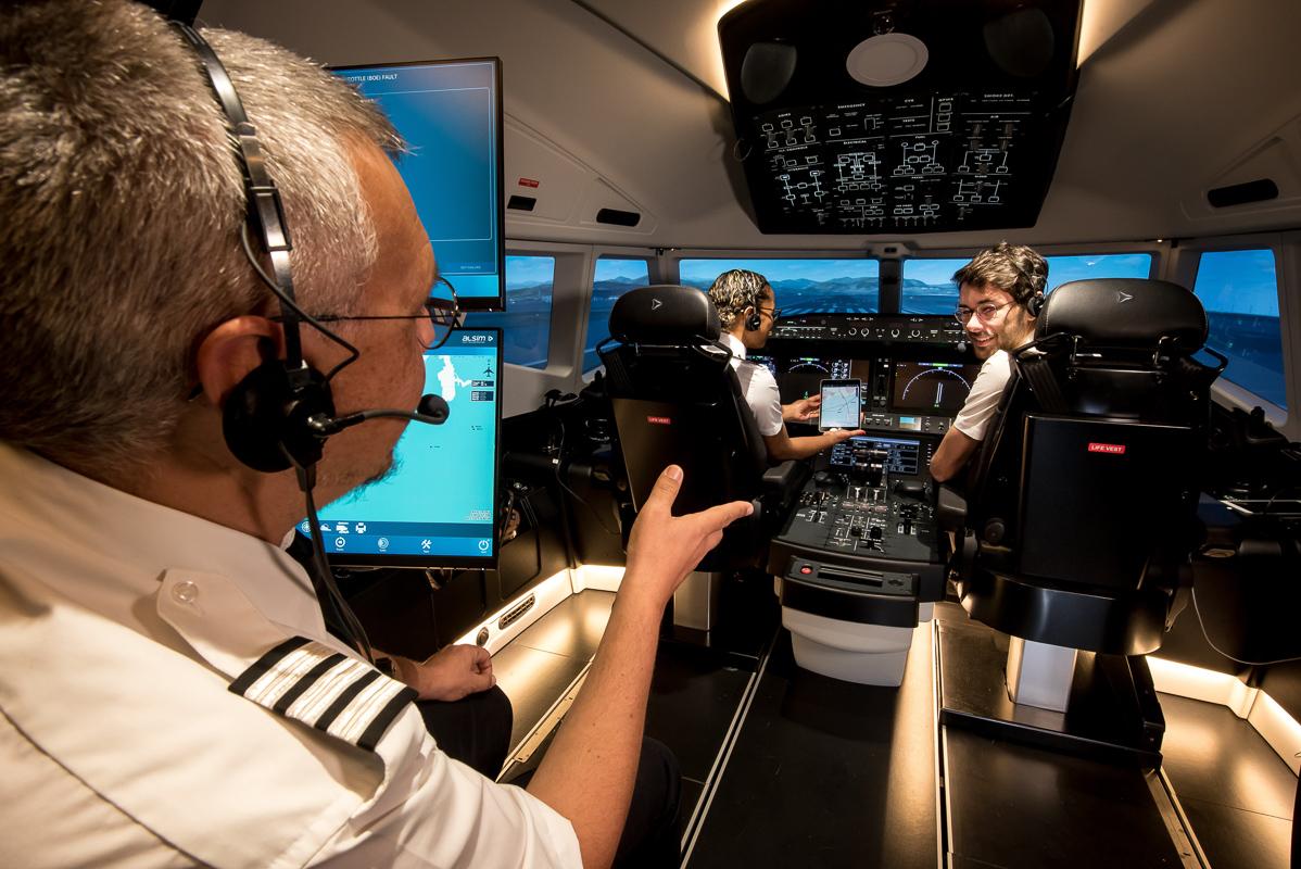 Interior view of cockpit, Instructor talking to pilots in Alsim Airliner flight simulator